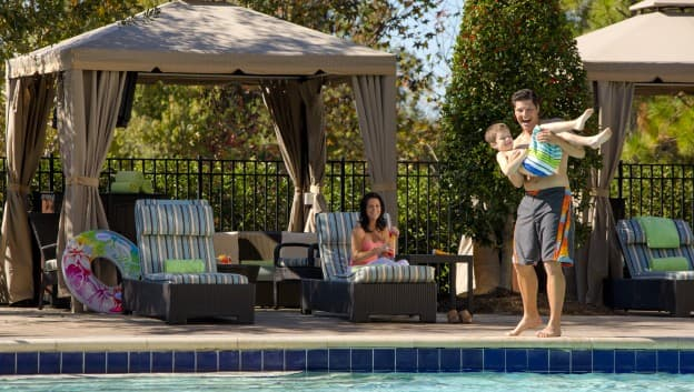Family by cabanas at the pool