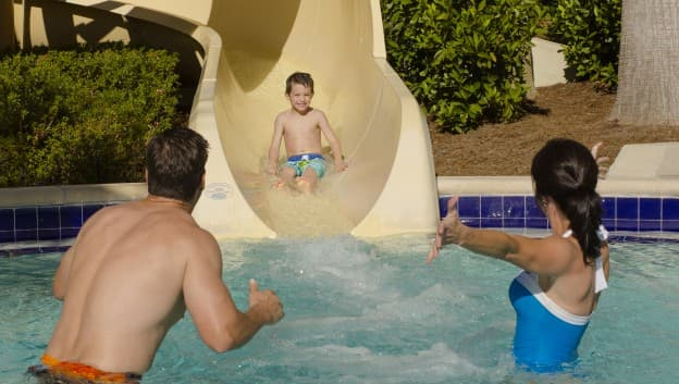 Child sliding down water slide