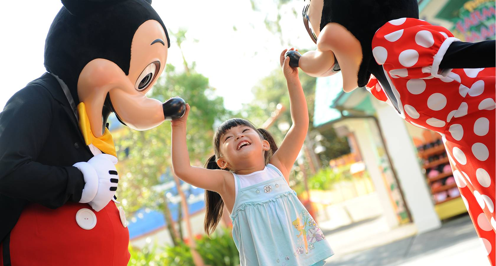 Girl with Mickey and Minnie Mouse