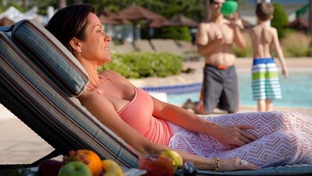 Woman sunbathing on cabana