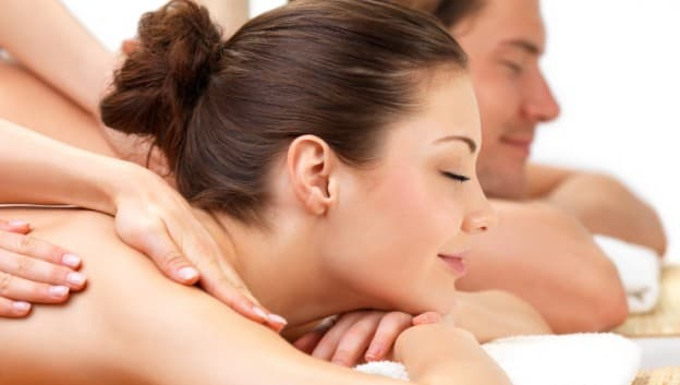 Couple receiving back massage