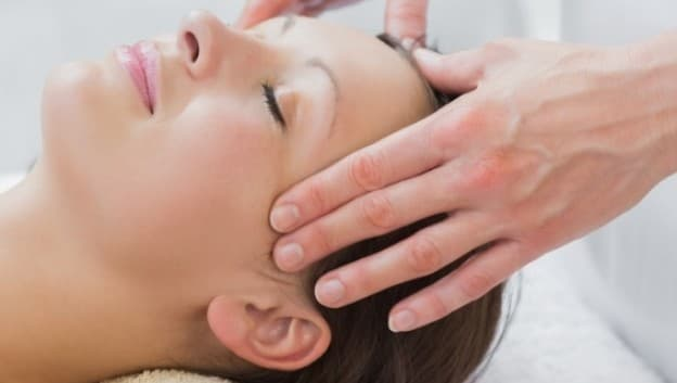 Woman receiving head massage