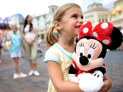 Girl holding Minnie Plush