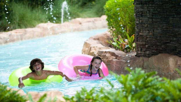 Family enjoying lazy river on rubber rings